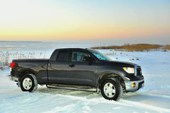 Darkly gray SUV on the snow covered Lake. Darkly gray SUV sport utility vehicle on the snow covered Lake. Ladoga Lake Russia Stock Images