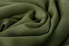 Darkly green fabric. As a background for design works Stock Image