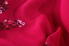 Darkly red fabric. With an embroidery from seed bead for use as a background Stock Image