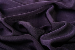 Darkly violet fabric. As a background for design works Royalty Free Stock Photo
