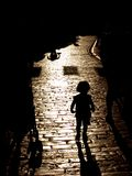 Darkness. Little girl  with the shadows Stock Images