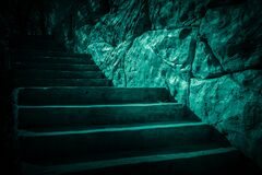 Free Darkness And Horror, Ghost House. Dark Stone Ruined Old Staircase From The Basement With Mystical Shadows And Strange Light Royalty Free Stock Images - 175518299