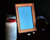 In darkness empty photo Frame, Pills, Medicine Bottles Stock Images
