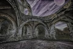 Darkness falls over a ruined abbey. royalty free stock image