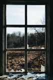 Darkness of human existence. View from a window of an abandoned house stock photos