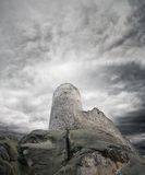 Darkness of middle-ages. Ruins of spooky dark castle with with storm clouds in the background stock images