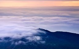 Darkness mountain and thick white cloud Royalty Free Stock Photos