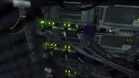 Darkness in the server room. Flashing green server lamp LED. Network ethernet switch. stock footage