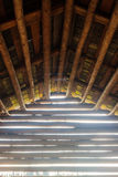 From Darkness To Light. Inside an old wooden barn house. The autumn light creates a powerful effect stock photo