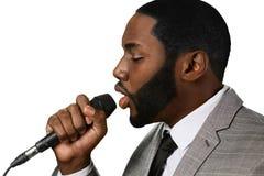 Darkskinned man sings jazz. Royalty Free Stock Image