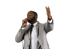 Darkskinned preacher. A darkskinned preacher. Praise the Lord. Motivational speech. Follow the light royalty free stock photos