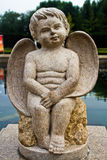 The Darling angel was sitting, sculpture Stock Image