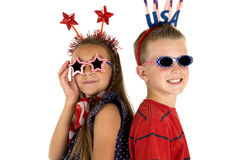 Darling boy and girl wearing cute patriotic sunglasses Stock Photo