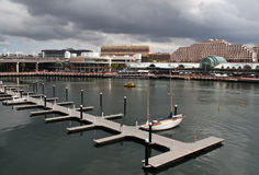Darling Harbour. In Sydney, Australia, with dark clouds in the background Stock Photo