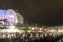 Darling Harbour bustling night scene. Night shot showing the bustling atmosphere at the Harbourside shopping centre of Darling Harbour (Sydney, Australia&# Royalty Free Stock Photos