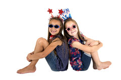 Darling USA patriotic girls sitting missing front teeth smiling. Patriotic girls sitting missing front teeth smiling Stock Images