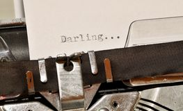 Darling word typed on old black typwriter Stock Image