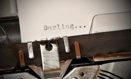 Darling word typed on old black typwriter Royalty Free Stock Photos