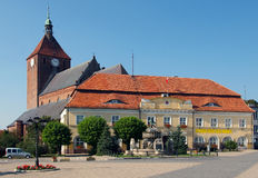 Darlowo church and town hall. The church is dating back from the XIVth century. The building in front of it is the town hall, and in front of the hall there is a Stock Photography