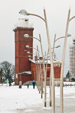 Darlowo lighthouse in winter Poland. The landmark of Darlowo Poland. Baltic sea scenic in winter, red brick lighthouse and modern lampposts Royalty Free Stock Photography