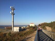 Darlowo Poland: dune walkway with tourists stock photography
