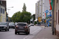 Darmstadt street Dreieich. Dreieich, Germany - September 09, 2017: Road traffic in front of the Aral gas station in the Darmstadt Street on September 09, 2017 in Stock Photography