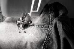Darn jeans on the machine Royalty Free Stock Image
