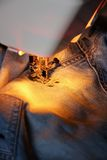 Darn jeans on the machine Royalty Free Stock Photos