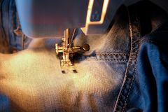 Darn jeans on the machine Royalty Free Stock Photo