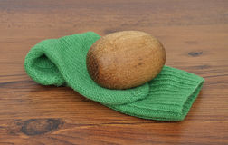 Darning egg with hand-knitted sock Royalty Free Stock Images