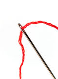 Darning needle and red thread. A macro of a needle and red thread royalty free stock photography