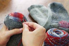 Darning socks stock photography