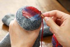 Darning socks royalty free stock image
