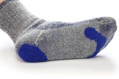 Darning socks, repairing holes in socks royalty free stock image