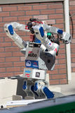 DARPA Robotics Challenge DRC Hubo Rolls through Rubble. POMONA, CA - JUNE 6: Team KAIST's DRC-Hubo robot successfully rolls through rubble at the DARPA Robotics royalty free stock images