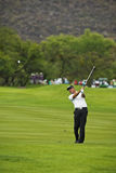 Darren Fichardt. Clubbing the ball up the 1st fairway, toward the green Stock Images