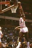 Darryl Dawkins of the Philadelphia 76ers. Darryl Dawkins slamming the Basketball thru Basket for the slam Royalty Free Stock Photo