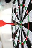 Dart. Direct hit with dart object Stock Photo