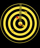 Dart. A yellow and black dart board Royalty Free Stock Images