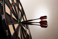 Dart. Three darts in the center of the disc Stock Image