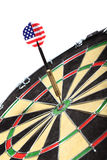 Dart with the American flag hitting a target board Royalty Free Stock Image