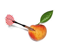 Dart in apple with green leaf Royalty Free Stock Image