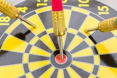 Dart arrow on center dartboard Royalty Free Stock Images