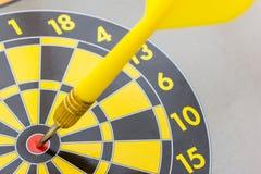 Dart arrow on center dartboard Stock Image