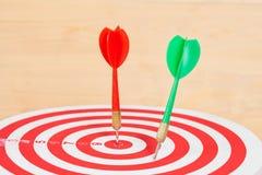 Dart arrow and dartboard on wood. Background Stock Photos