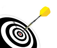 Dart arrow hits its target Stock Photo