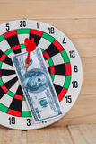 Dart arrow hitting in bulleye on dartboard Royalty Free Stock Images