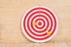 Dart arrow hitting in bulls eye Stock Image