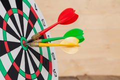 Dart arrow hitting in bullseye Stock Photos