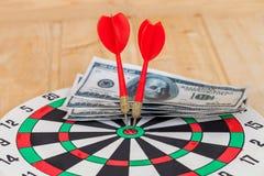 Dart arrow hitting in bullseye on dartboard Royalty Free Stock Photography